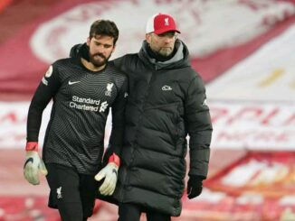 Alisson Becker and Jurgen Klopp