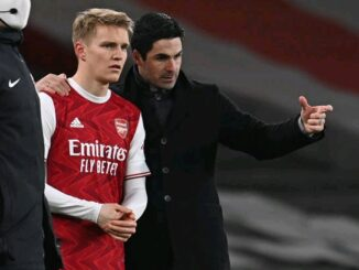 Odegaard and Mikel Arteta